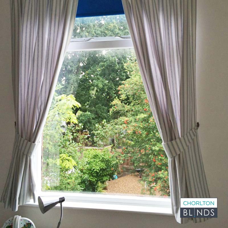 Bedroom curtains and blackout roller blind at the same window