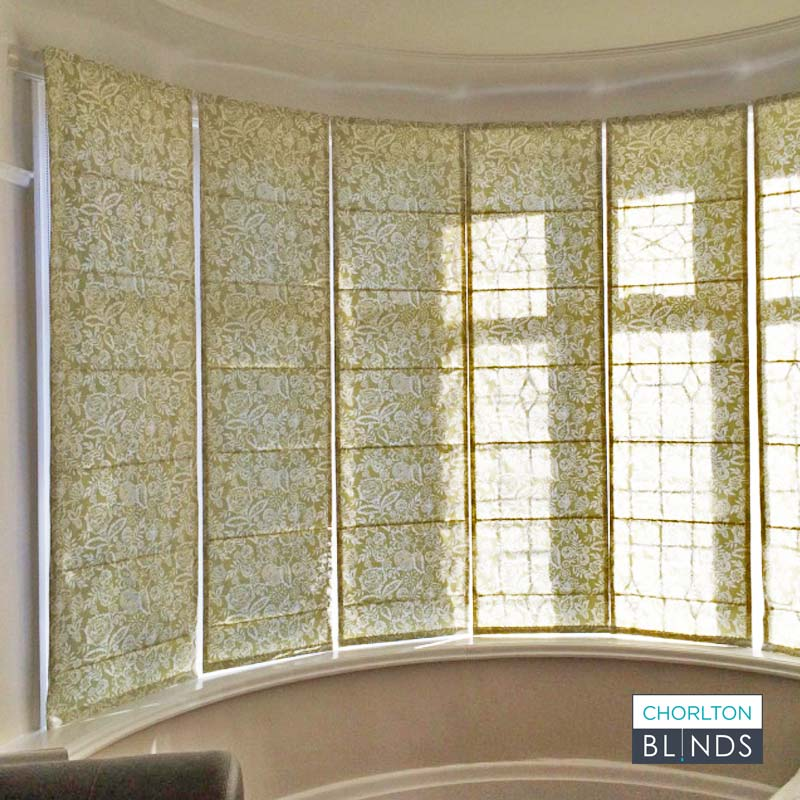 Curved Bay Window with Green Patterned Roman Blinds