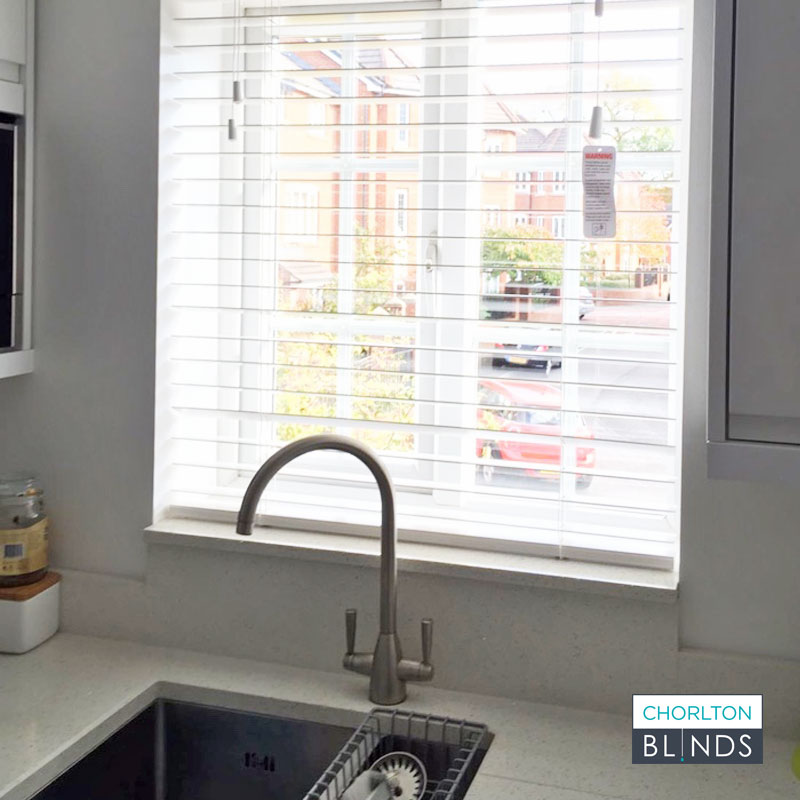 Small Faux Wood Blind at Kitchen Window