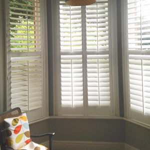 Plantation shutters in Chorlton bay window in white painted finish