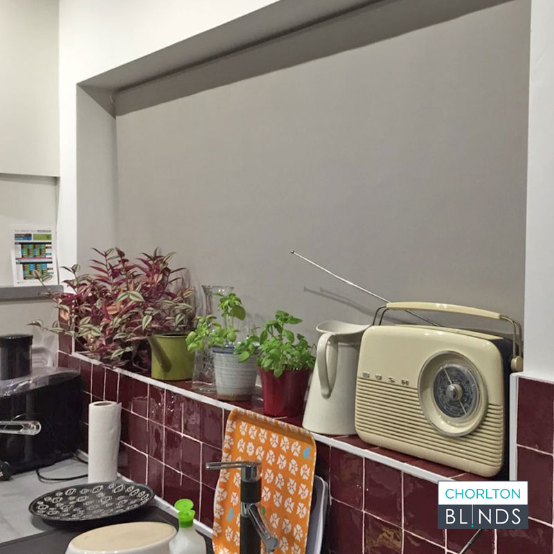 Kitchen Window With Grey Roller Blind