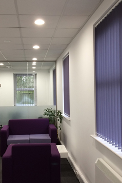 office with matching purple vertical blinds and furniture